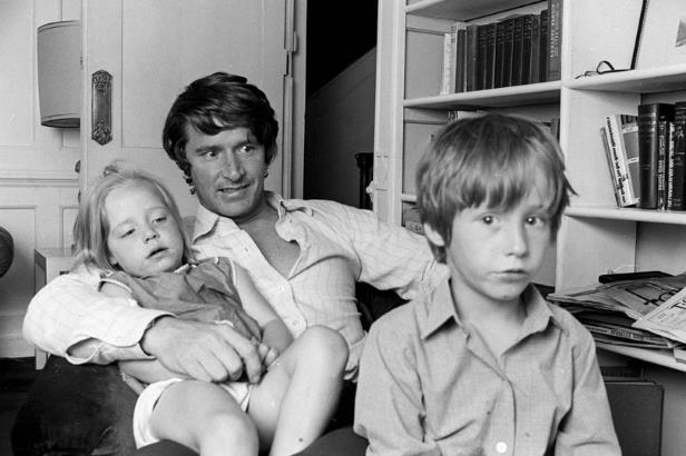 a young boy standing in front of a window: William Roache and children Linus and Vanya (Image: REX/Shutterstock)