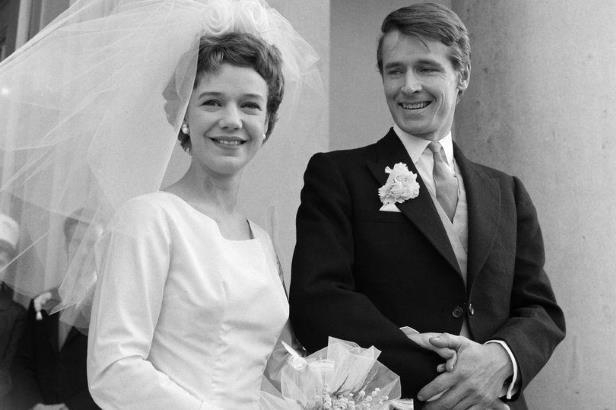 Anna Cropper and woman posing for a photo: William Roache and Anna Cropper on their wedding day in 1961 (Image: The People)