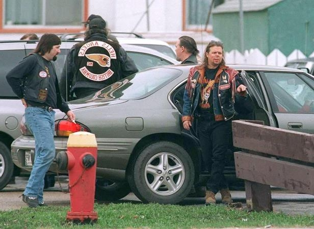 Hells Angels member Walter Stadnik, left, is shown at a Winnipeg funeral during the early 1990's.