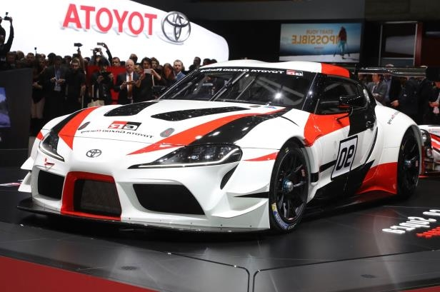 Slide 1 of 52: Toyota-GR-Supra-Racing-Concept-front-side-view-on-stage.jpg