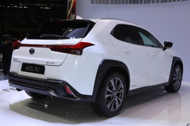 Slide 13 of 56: 2019-Lexus-UX-rear-side-view.jpg