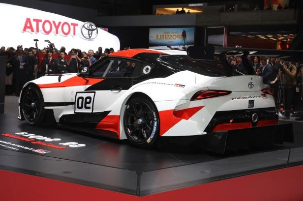 Slide 2 of 52: Toyota-GR-Supra-Racing-Concept-rear-side-view.jpg