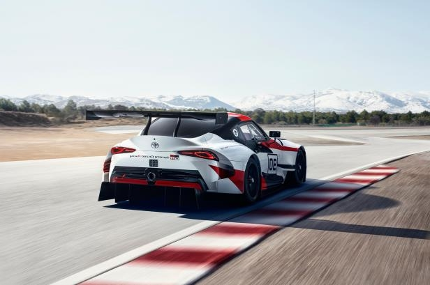 Slide 24 of 52: Toyota-GR-Supra-Racing-Concept-rear-three-quarter-in-motion.jpg