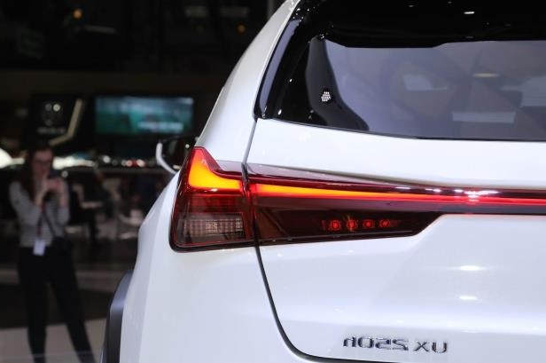 Slide 3 of 56: 2019-Lexus-UX-250h-taillight-and-badge.jpg