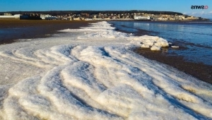 water next to the ocean: Stunning Photos Show Beach Frozen Over by 'Beast from the East'