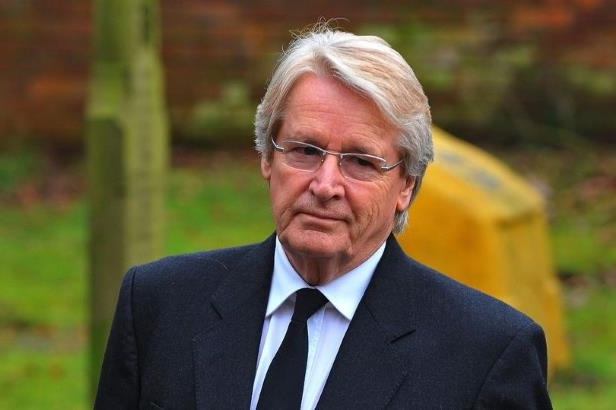 William Roache wearing a suit and tie: He has been granted compassionate leave from the show (Image: Daily Mirror)
