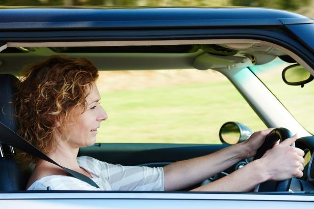 a person driving a car: A new study shows what matters when it comes to how much you pay for car insurance.