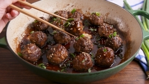 a bowl of food on a plate: These General Tso's Meatballs Are Insanely Addictive