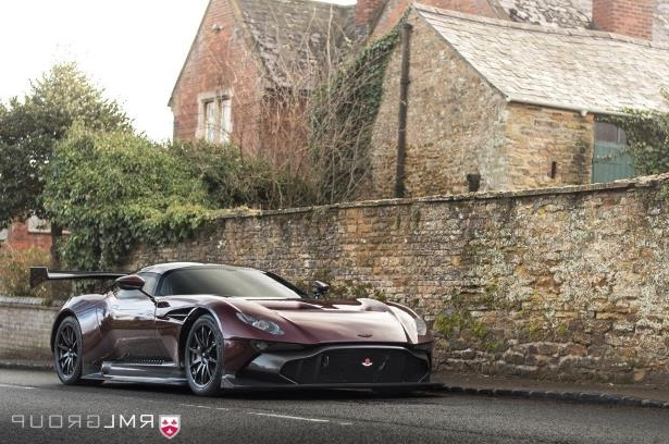 a car parked in front of a brick building: Here's Everything That Was Changed to Make the Aston Martin Vulcan Road Legal