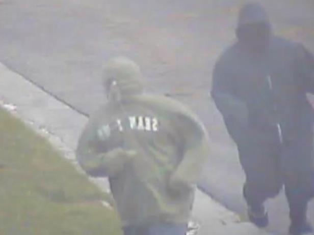 a close up of a logo: Two men in hoodies are seen running towards Fabio Sementilli's house the afternoon of his murder