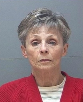 a person with collar shirt: Linda Tracy Gillman, 70, was charged for attempting to hire a hit man to kill two people. This was the third time she allegedly attempted to do so.