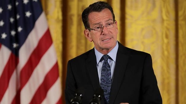 Dannel Malloy wearing a suit and tie
