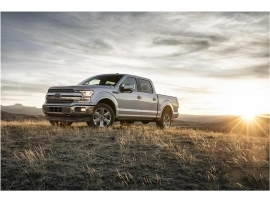 a car parked in a field: 2018 Ford F-150