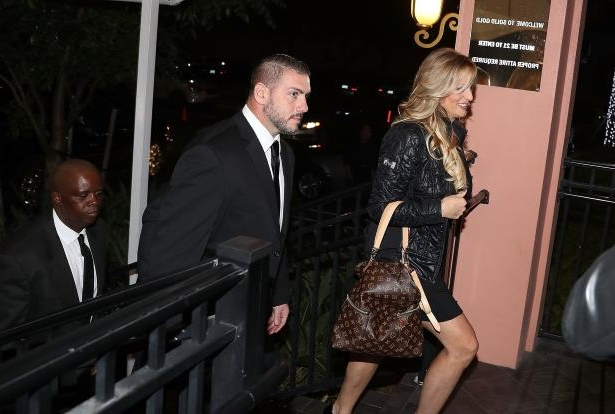 a couple of people that are talking to each other: Stephanie Clifford, who uses the stage name Stormy Daniels, arriving to perform at a strip club in Fort Lauderdale, Fla.