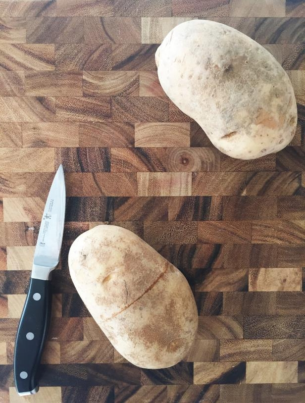 a cut in half on a blanket: This Hack Will Forever Change the Way You Peel Potatoes