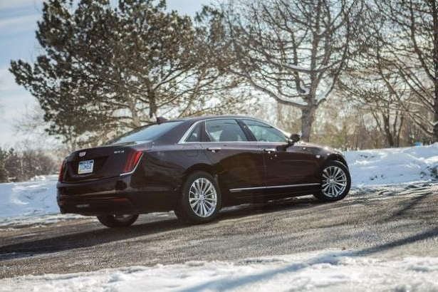 a car parked on the side of a road: 2018 Cadillac CT6 Plug-In
