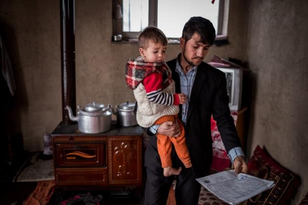 a man and a woman standing in a kitchen: Sayed Assadullah with his son Donald Trump at their rented home in Kabul.