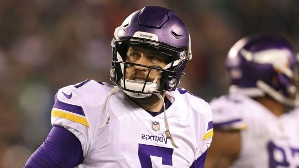 a person wearing a helmet: Case Keenum playing for the Vikings