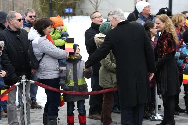 Belgium's King Philippe greets members of the public -- including a child with a Belgian flag -- at Rideau Hall with Canadian Governor General Julie Payette