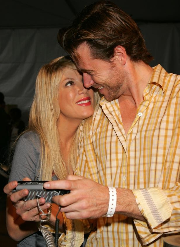 Slide 1 of 16: <p>Tori Spelling and Dean McDermott meet in Ottawa, Canada, while filming the TV movie Mind Over Murder. Both are married to other people at the time: McDermott to his wife of over a decade, Mary Jo Eustace, and Spelling soon-to-be-separated from her husband Charlie Shanian.</p>