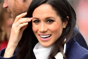 The Significance Of Meghan Markle's New Diamond Cross Bracelet