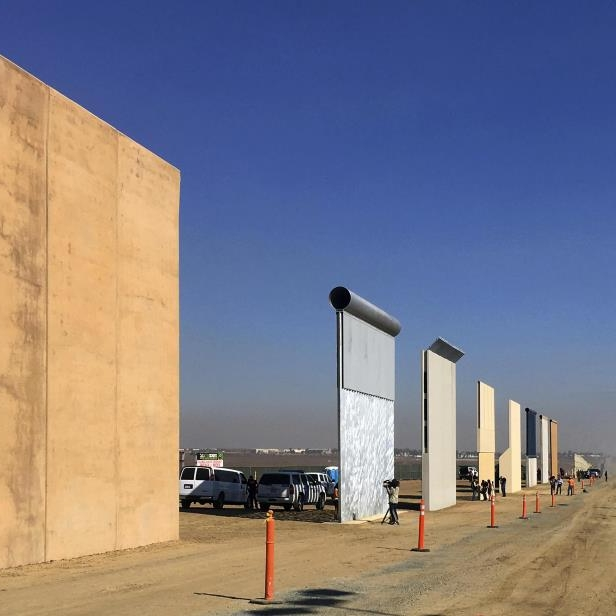 This Oct. 26, 2017 file photo shows prototypes of border walls in San Diego. Rigorous testing of prototypes of President Donald. A U.S. official says recent testing of prototypes of President Donald Trump's proposed wall with Mexico found their heights should stop border crossers. U.S. tactical teams spent three weeks trying to breach and scale the models in San Diego. An official with direct knowledge of the results said they point to see-through steel barriers topped by concrete as the best design. The official spoke to The Associated Press on condition of anonymity because the information is not authorized for release.: Border Wall Prototypes