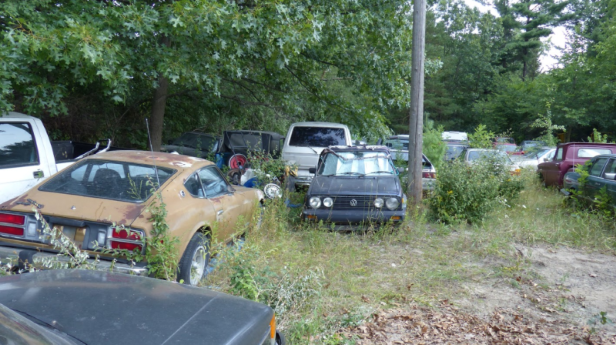 a car parked on the side of a road: Ron's collection as of this past summer.