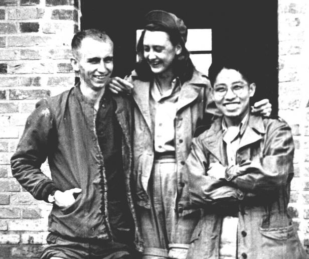 a group of people posing for a photo: Elizabeth McIntosh, center, who conducted psychological warfare for the Office of Strategic Services, works in China during WWII. The OSS later became the CIA. (The OSS Society)