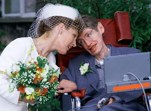 a man holding a flower: Dr. Hawking married Elaine Mason in 1995.