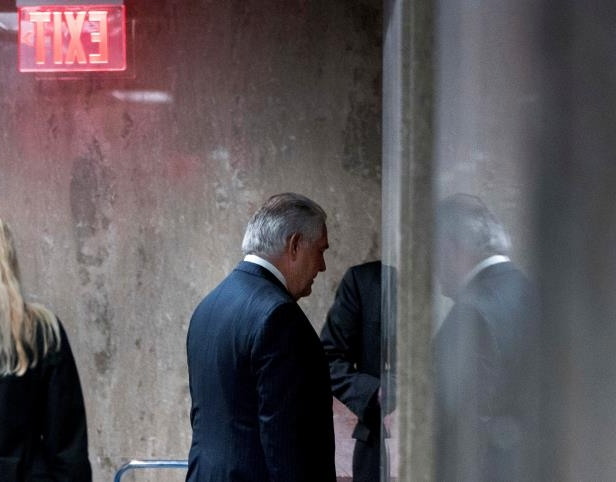 Secretary of State Rex Tillerson walks down a hallway after speaking at a news conference at the State Department in Washington, Tuesday, March 13, 2018. President Donald Trump fired Tillerson and said he would nominate CIA Director Mike Pompeo to replace him, in a major staff reshuffle just as Trump dives into high-stakes talks with North Korea. (AP Photo/Andrew Harnik)