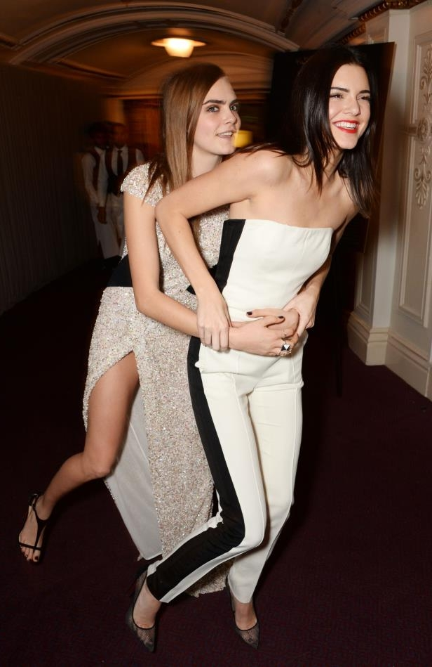 Slide 26 of 40: Kendall Jenner (L) and Model of the Year winner Cara Delevingne attend the British Fashion Awards at the London Coliseum on December 1, 2014 in London, England.