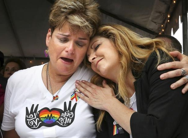Slide 5 of 20: Pulse nightclub owner Barbara Poma comforts Orlando City commissioner Patty Sheehan, right, Monday, June 12, 2017, during a ceremony at the club in Orlando, Fla., on the one-year anniversary of the June 12, 2016, shooting that killed 49 at Pulse.