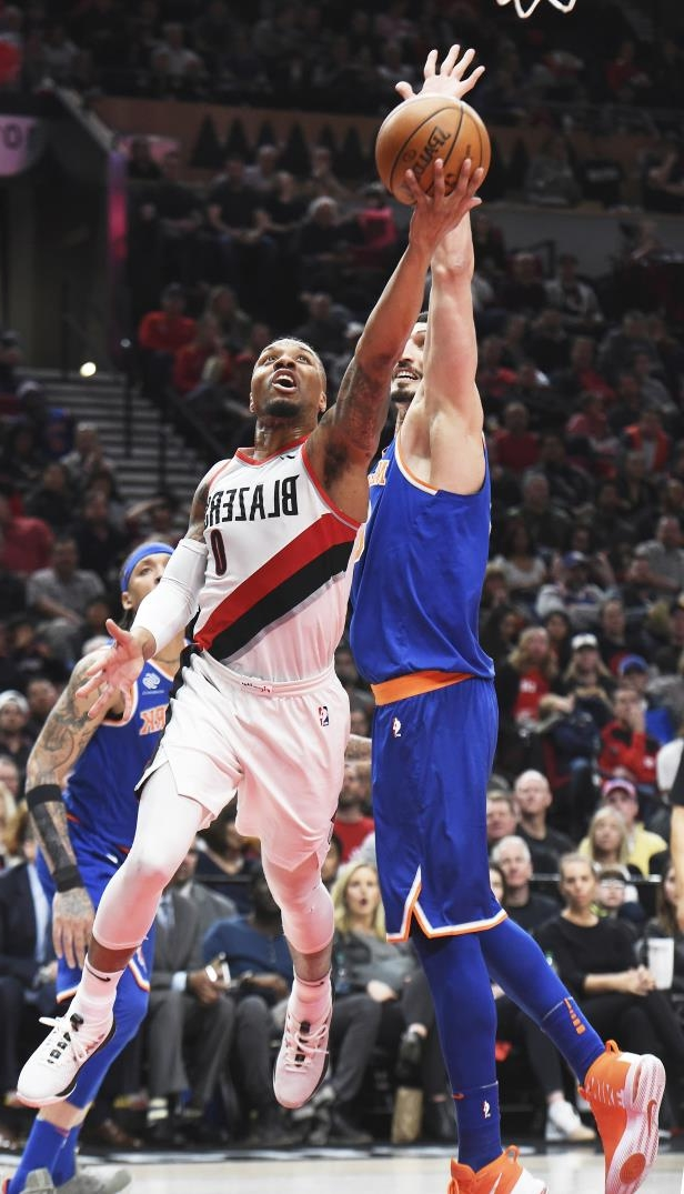 Slide 50 of 83: Portland Trail Blazers guard Damian Lillard drives to the basket as New York Knicks center Enes Kanter defends during the second half of an NBA basketball game in Portland, Ore., Tuesday, March 6, 2018. Lillard scored 37 points as the Blazers won 111-87.