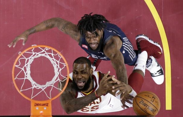 Slide 55 of 83: Cleveland Cavaliers' LeBron James, right, loses control of the ball under pressure from Detroit Pistons' Reggie Bullock in the first half of an NBA basketball game, Monday, March 5, 2018, in Cleveland.