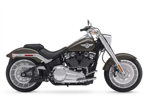 a motorcycle parked on the side of a road: Would you pay a $4 premium for a brand-new Harley-Davidson Fat Boy?