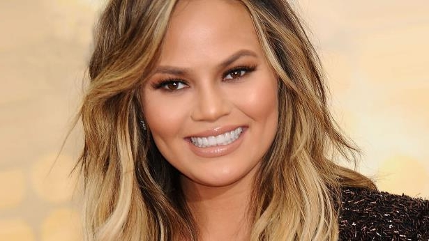 Chrissy Teigen smiling for the camera