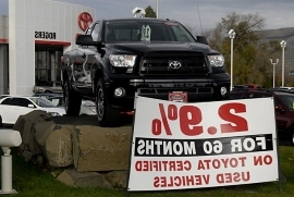 a truck with a sign: Five Steps to Landing a Good Car Loan