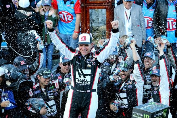 Clint Bowyer, driver of the #14 Haas Automation Demo Day Ford, celebrates in Victory Lane after winning the weather delayed Monster Energy NASCAR Cup Series STP 500 at Martinsville Speedway on March 26, 2018 in Martinsville, Va.