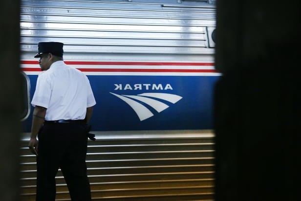 a man standing in front of a window: Amtrak is having a busy Easter weekend.