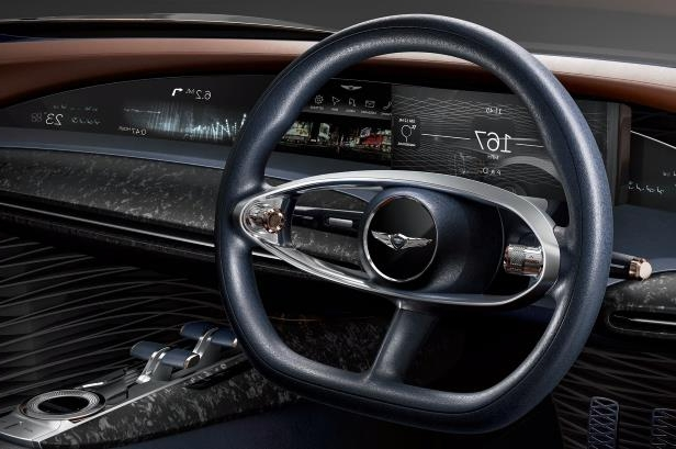 Slide 24 of 26: Genesis-Essentia-concept-steering-wheel.jpg