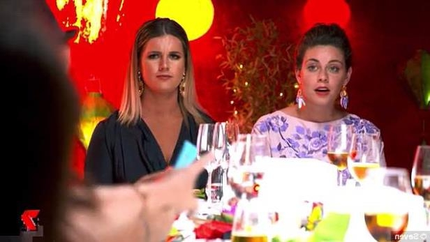 a woman sitting at a table: Taking aim: Sonya and Hadil then continue to threaten the entire table, telling contestants that they will 'come for them'