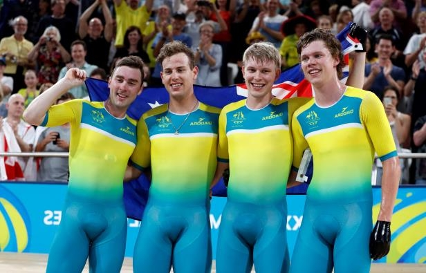 Alex Porter, Sam Welsford, Leigh Howard and Kelland O'Brien of Australia celebrate after winning the gold medal.