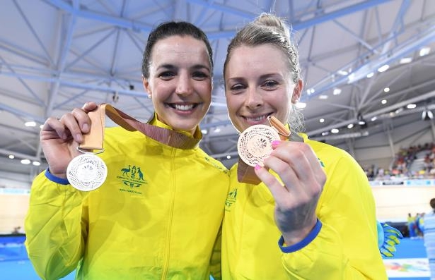 Bronze medalist Annette Edmondson (left) of Australia and silver medalist Rebecca Wiasak of Australia.