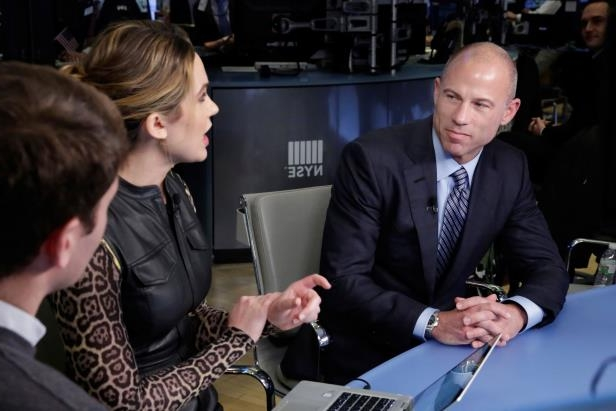 Michael Avenatti is interviewed on Thursday by Kristen Scholer on the floor of the New York Stock Exchange.
