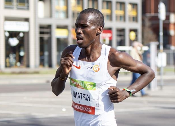 Erick Kiptanui from Kenya is on his way to win the Berlin Half-Marathon race in Berlin, Germany, Sunday, April 8, 2018. (Christophe Gateau/dpa via AP)