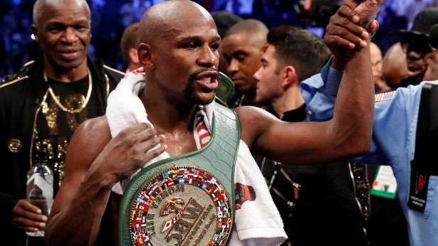 Floyd Mayweather Jr. celebrates with the belt after winning the fight against Conor McGregor (not shown) in Las Vegas, Nevada, U.S. on 26 August 2017.: The 41-year-old boxer retired in August 2017 with a perfect career record of 50 unbeaten fights