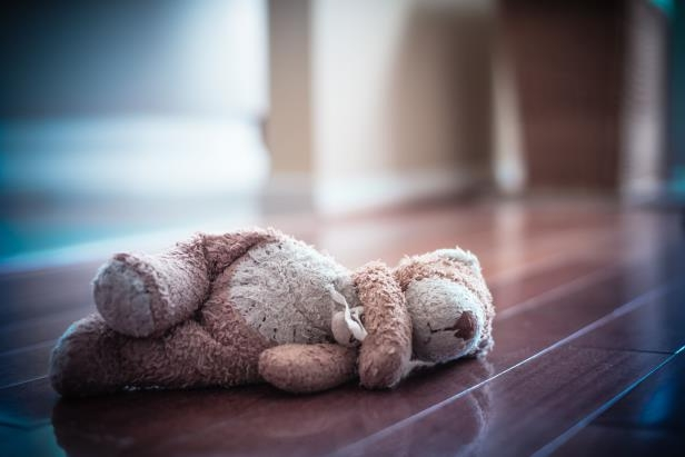 Sad teddy bear left