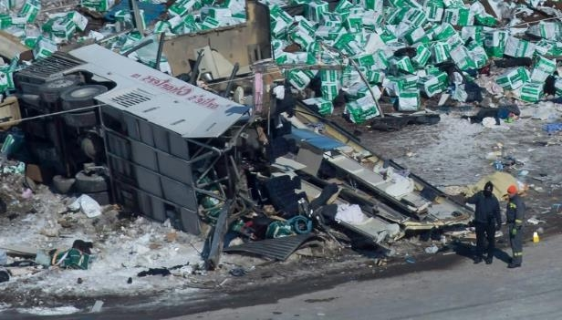 The wreckage of the fatal crash outside of Tisdale, Sask., is seen Saturday. A bus carrying the Humboldt Broncos hockey team crashed into a truck en route to Nipawin for a game Friday night.
