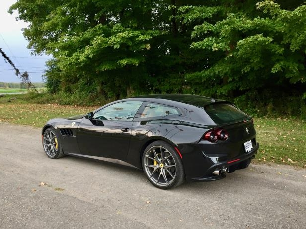 a car parked on the side of a road: 2017 Ferrari GTC4Lusso Review