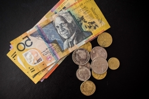 Aussie dollar inches higher as markets recover
